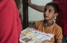 Sultan shows a drawing he sketched for Save the Children.   The boy was overcome with despair before deciding to seek Save the Children for support.